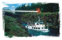 The MV Schwatka sails through historic Miles Canyon on the Yukon River. Click for more information